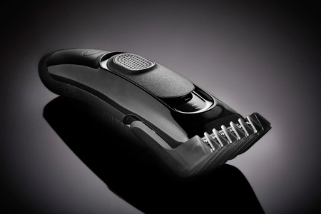 clipper: hair clipper on a black background Stock Photo