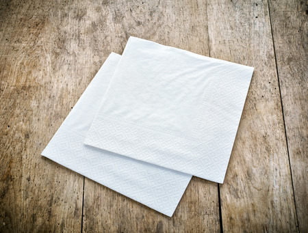 angle bar: white paper napkins on old wooden table