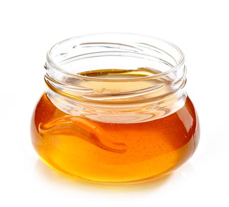 frasco: tarro de miel aislado en el fondo blanco