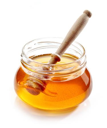 honey: jar of honey isolated on white background