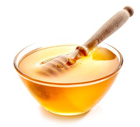 bowls: bowl of honey isolated on white background