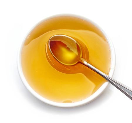 jarabe: Tazón de miel aislado en fondo blanco, vista superior