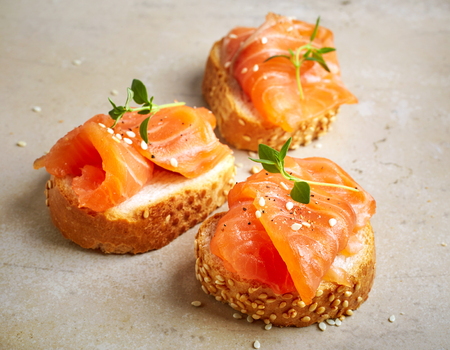 gourmet kitchen: bread with salmon fillet on kitchen table