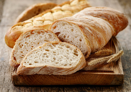 ciabatta: Ciabatta bread on wooden cutting board