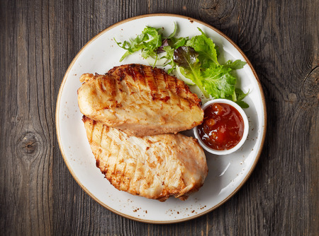 white plate: Grilled chicken fillet on white plate
