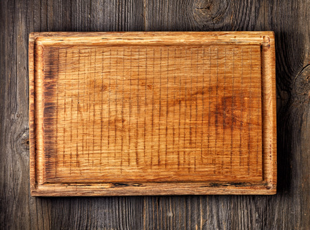 cutting board: old wooden cutting board, top view