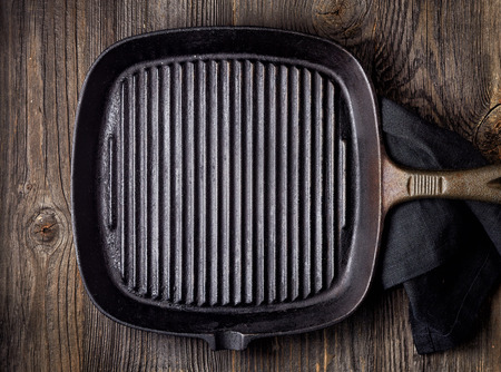 pan: empty black cooking pan on wooden table, top view