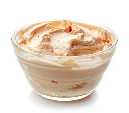 cream cheese: bowl of cream cheese with paprika and tomato, dip sauce isolated on white background