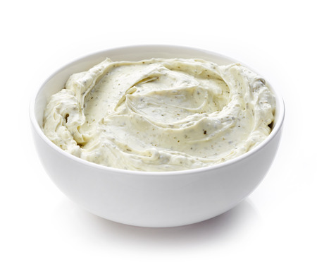 bowl of cream cheese with herbs, dip sauce isolated on white background