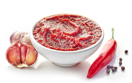 chilies: bowl of hot chili and garlic sauce isolated on white background