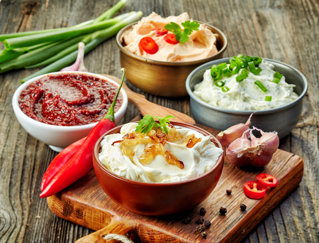 party food: various dip sauces on wooden table
