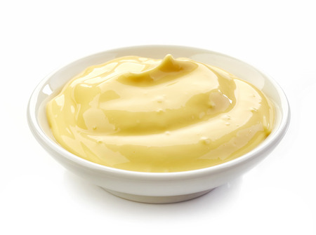 isolated on yellow: bowl of mayonnaise isolated on white background