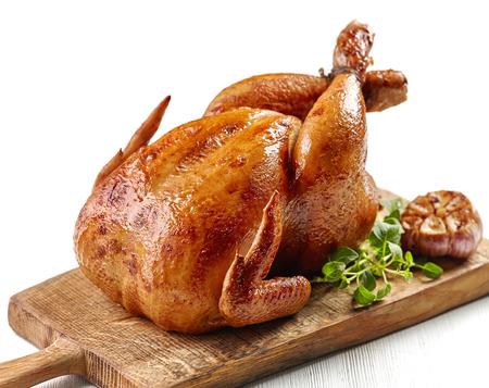 roasted chicken on wooden cutting board Foto de archivo