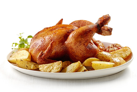 dish: roasted chicken and potatoes on white plate