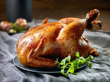 baked chicken: roasted chicken on gray plate Stock Photo