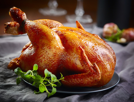roasted chicken: roasted chicken on gray plate Stock Photo