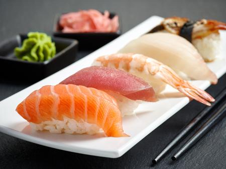 sushi chopsticks: various sushi on white plate