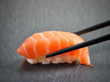 sushi: Salmon sushi on black background