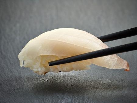 sea bream: sea bream sushi on black background Stock Photo