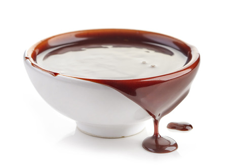 chocolate sauce: Bowl of chocolate sauce isolated on white background