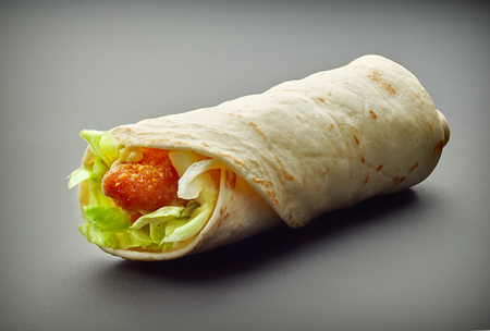 fried chicken: Wrap with fried chicken and vegetables on a gray background Stock Photo