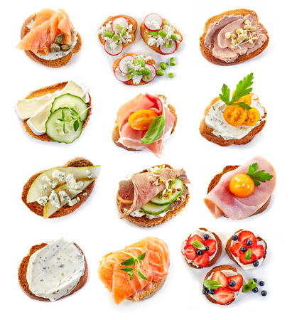 green top: various bruschettas isolated on white background, top view