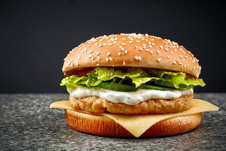 fresh chicken burger on dark background