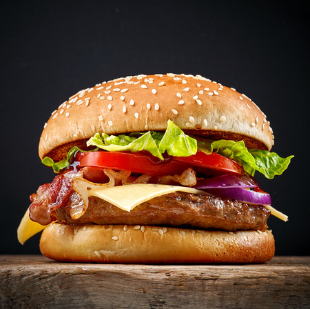 wooden table: fresh tasty burger on wooden table Stock Photo
