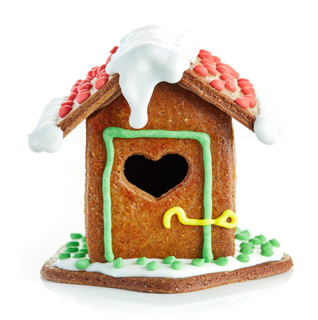 gingerbread house: homemade gingerbread house isolated on white background