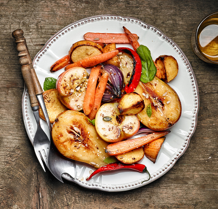 rutabaga: Roasted fruits and vegetables on white plate, top view