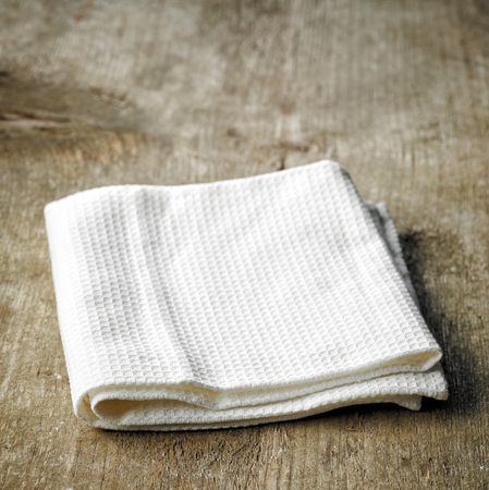 white towel: White towel on old wooden table Stock Photo