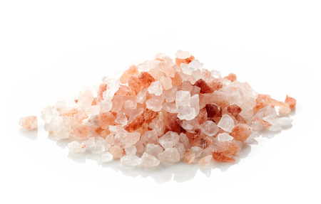himalayan salt: heap of pink himalayan salt isolated on white background