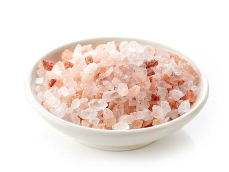 himalayan salt: bowl of pink himalayan salt isolated on white background