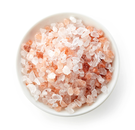 stone bowl: bowl of pink himalayan salt isolated on white background, top view