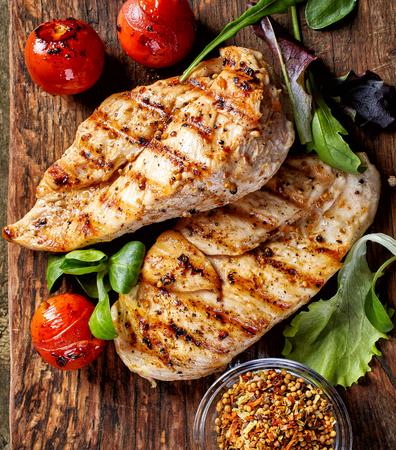 Grilled chicken fillets and vegetables, top view