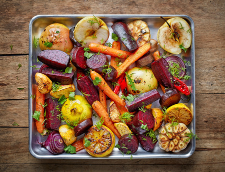 rutabaga: Roasted fruits and vegetables on wooden table, top view Stock Photo