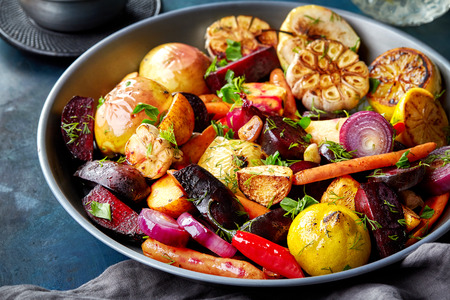 rutabaga: Various roasted fruits and vegetables on gray plate