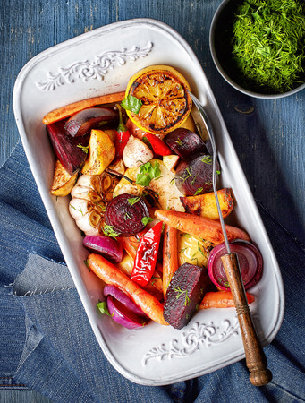 rutabaga: Roasted fruits and vegetables on blue wooden table, top view