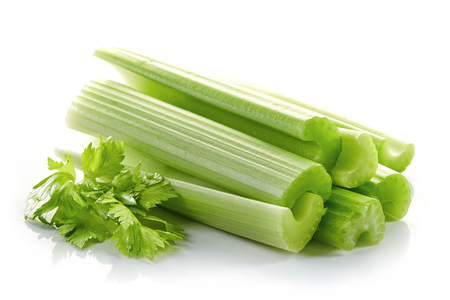 green celery sticks and leaf isolated on white background