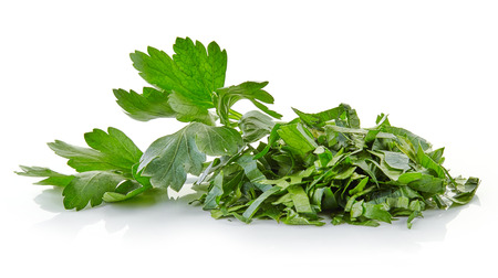 heap of chopped parsley leaves isolated on white background