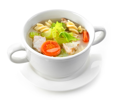 soup bowl: bowl of chicken and vegetable soup isolated on white background