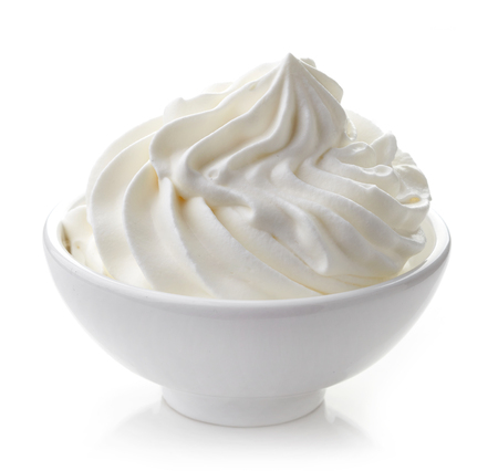 bowl of whipped cream isolated on white background