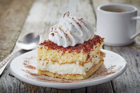 cake with whipped cream on wooden table