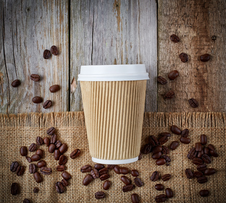 take away: paper take away coffee cup on wooden and linen background
