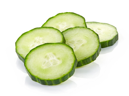 fresh cucumber slices isolated on white background Stock Photo - 52935712