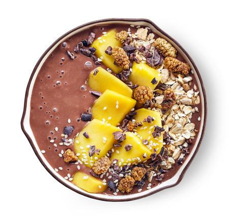 breakfast banana and chocolate smoothie bowl topped with mango and superfoods Фото со стока