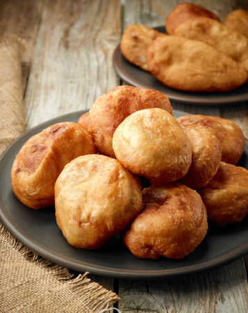 dark meat: fried meat pies belyashi on dark plate Stock Photo