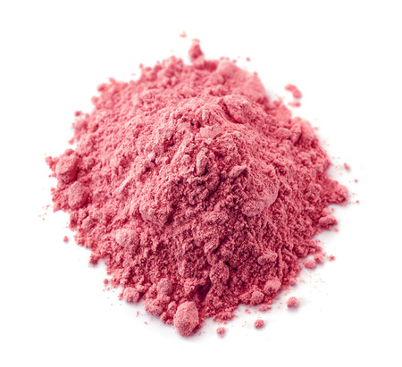 heap of dried pink berry fruit powder isolated on white background Foto de archivo