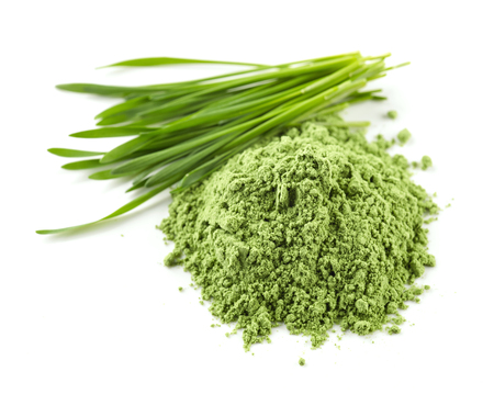 heap of green wheat powder isolated on white background, selective focus Stockfoto