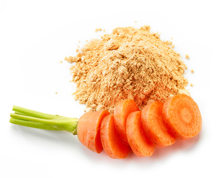 carrot: heap of dried carrot powder isolated on white background Stock Photo